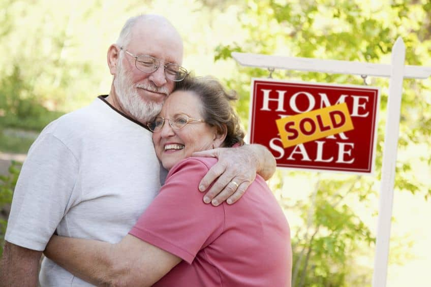 Happy elderly couple sold their house fast