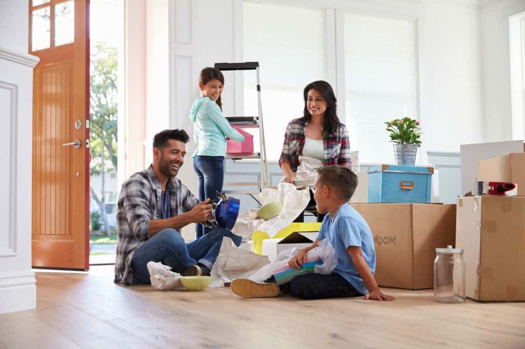 Happy family moving house - UK Property Cash Buyers