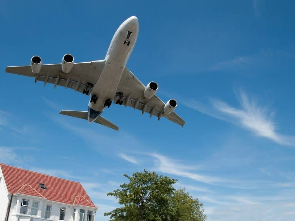 aeroplane flying over a house - UK Property Cash Buyers