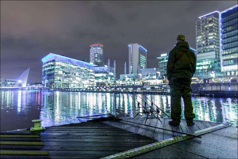 Man Fishing in Salford Quays - UK Property Cash Buyers