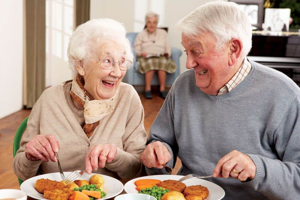 happy retired couple - UK Property Cash Buyers