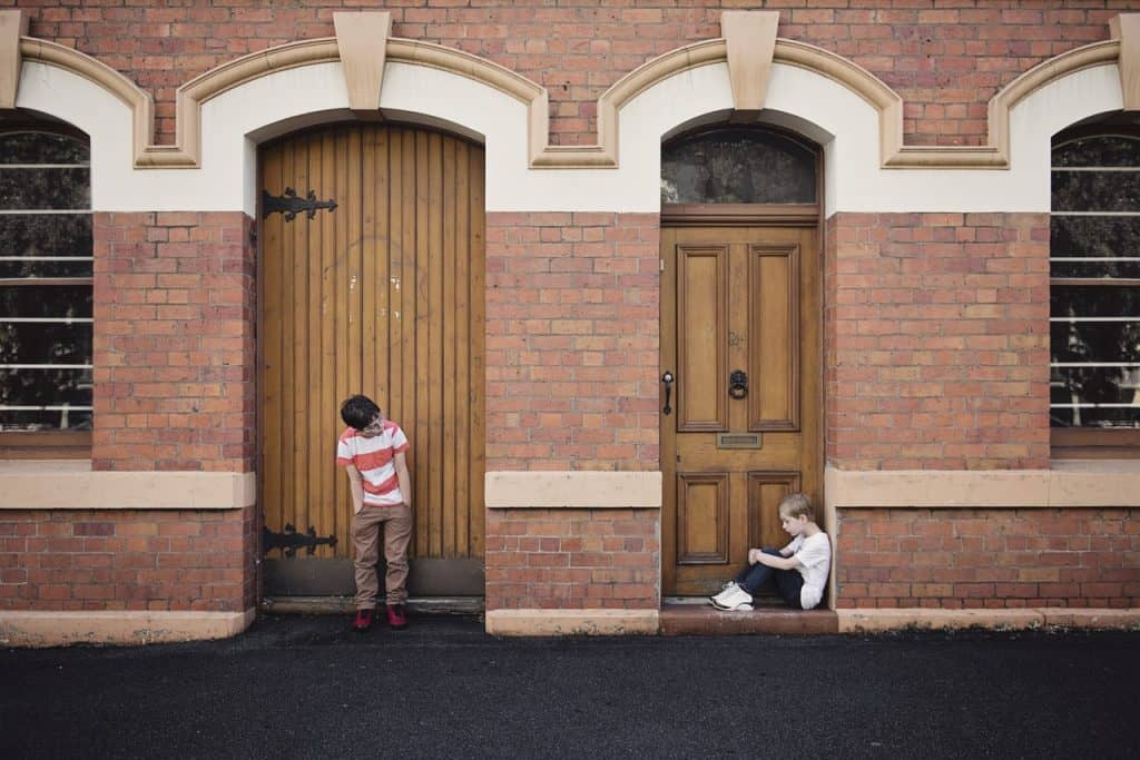 Children outside their family home - UK Property Cash Buyeres
