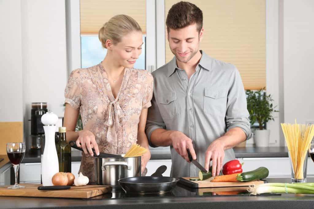 Couple cooking in the kitchen - UK Property Cash Buyers