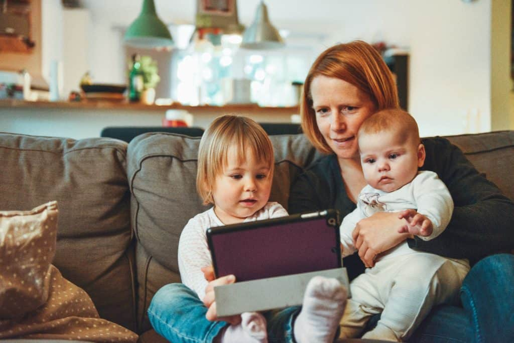 Mother and her children on an ipad - UK Property Cash Buyers