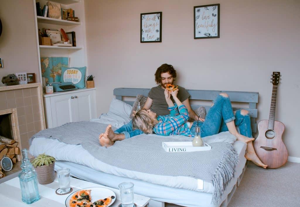 Happy couple in bedroom - UK Property Cash Buyers