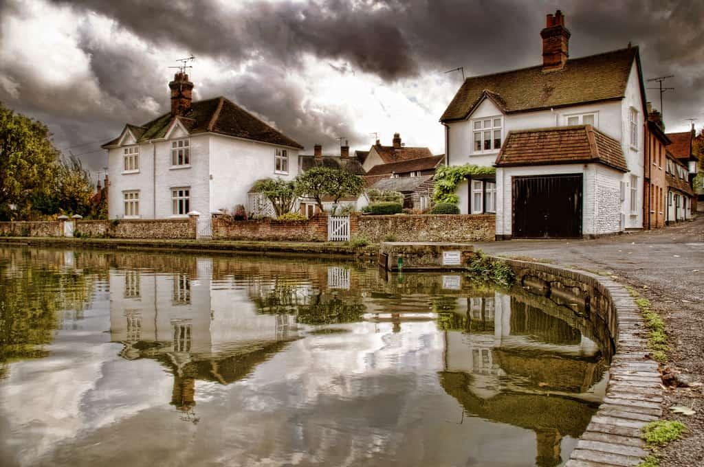 Houses under gloomy skies - UK Property Cash Buyers